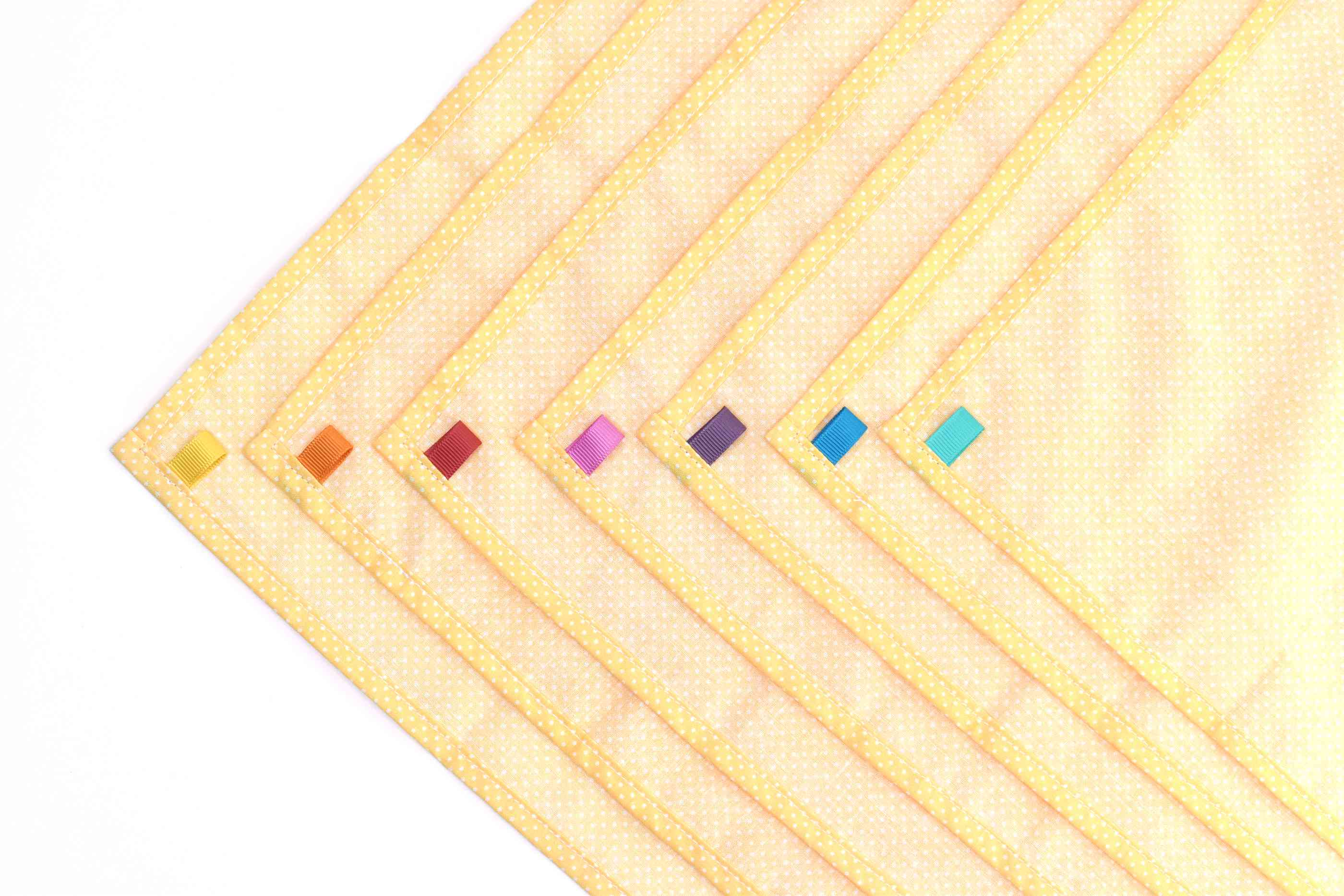 Add Color-Coded Ribbons to Each Cloth Napkin