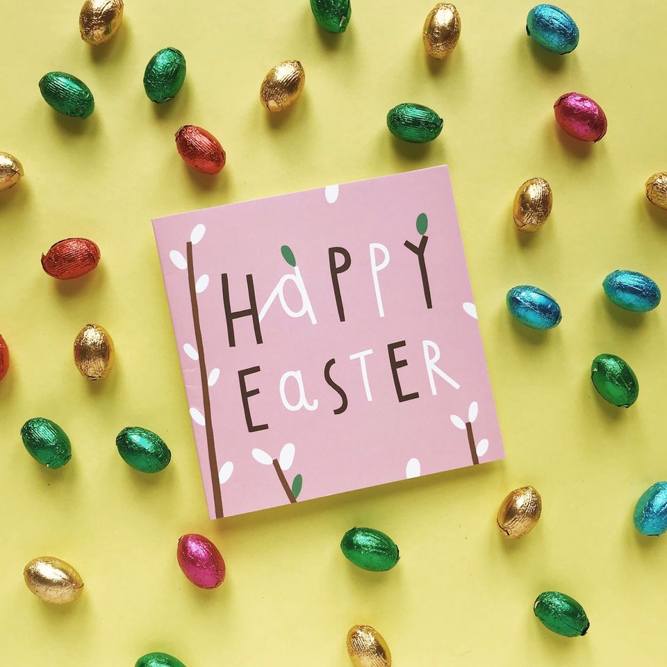 High Angle View Of Greeting Card With Easter Eggs On Yellow Background