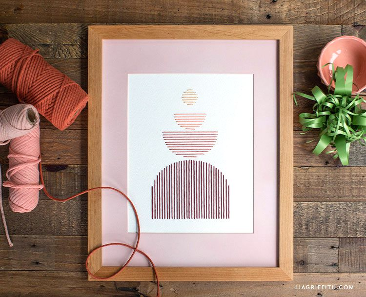 Embroidery floss artwork in wood frame