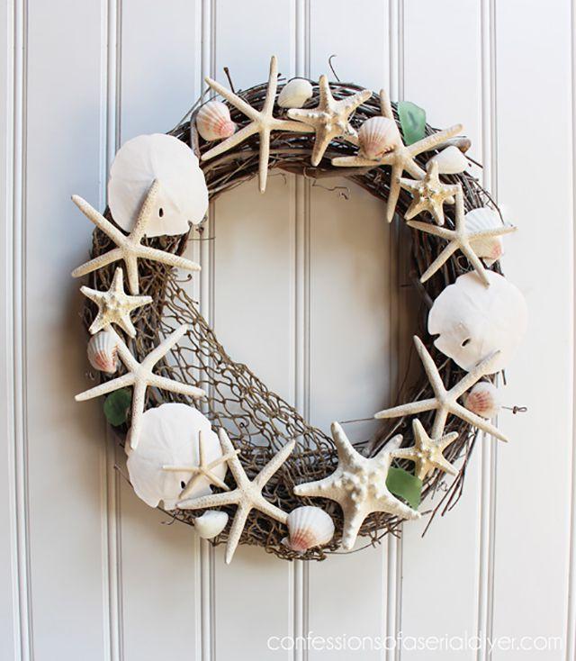 Seashell wreath on white wall