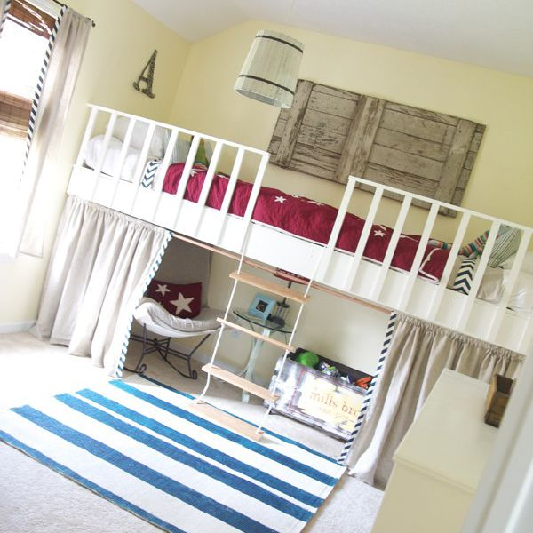 A loft bed with a ladder and hiding space