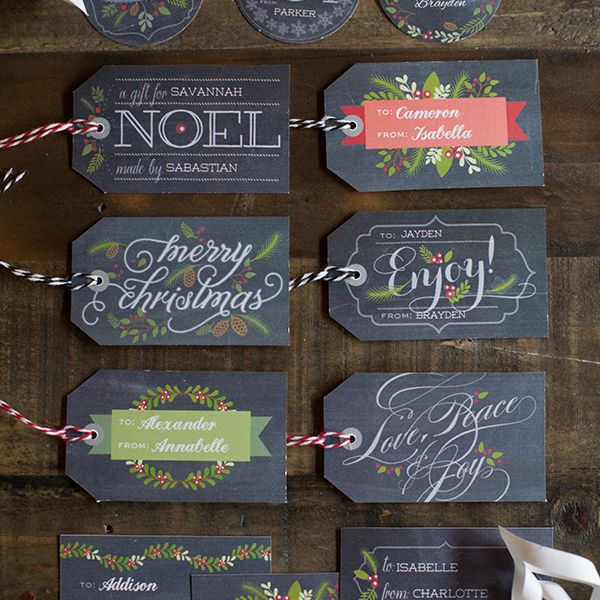 Chalkboard Style Christmas Gift Tags Laying On A Table