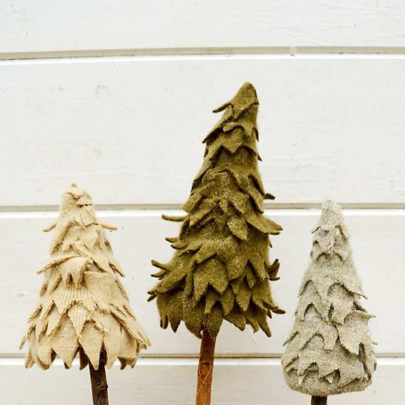 Green trees made from wood and scraps of felt.