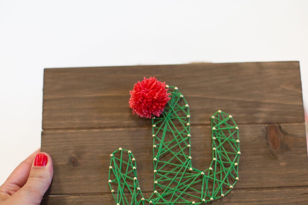 Tying a Pom Pom to Create Cute Cactus String Art