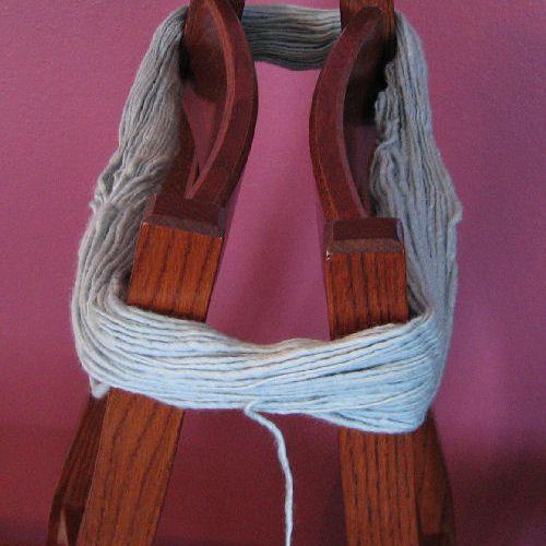 A hank of yarn on chairs.