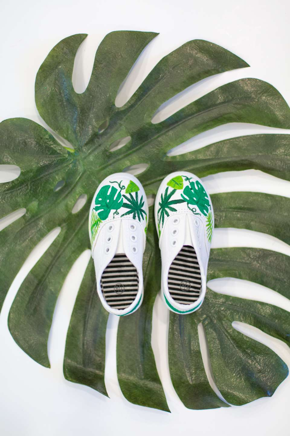 DIY painted shoes on a monstera leaf