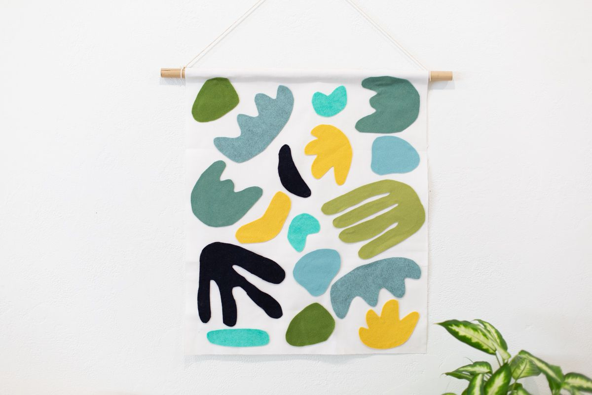 DIY felt wall tapestry hanging on wall