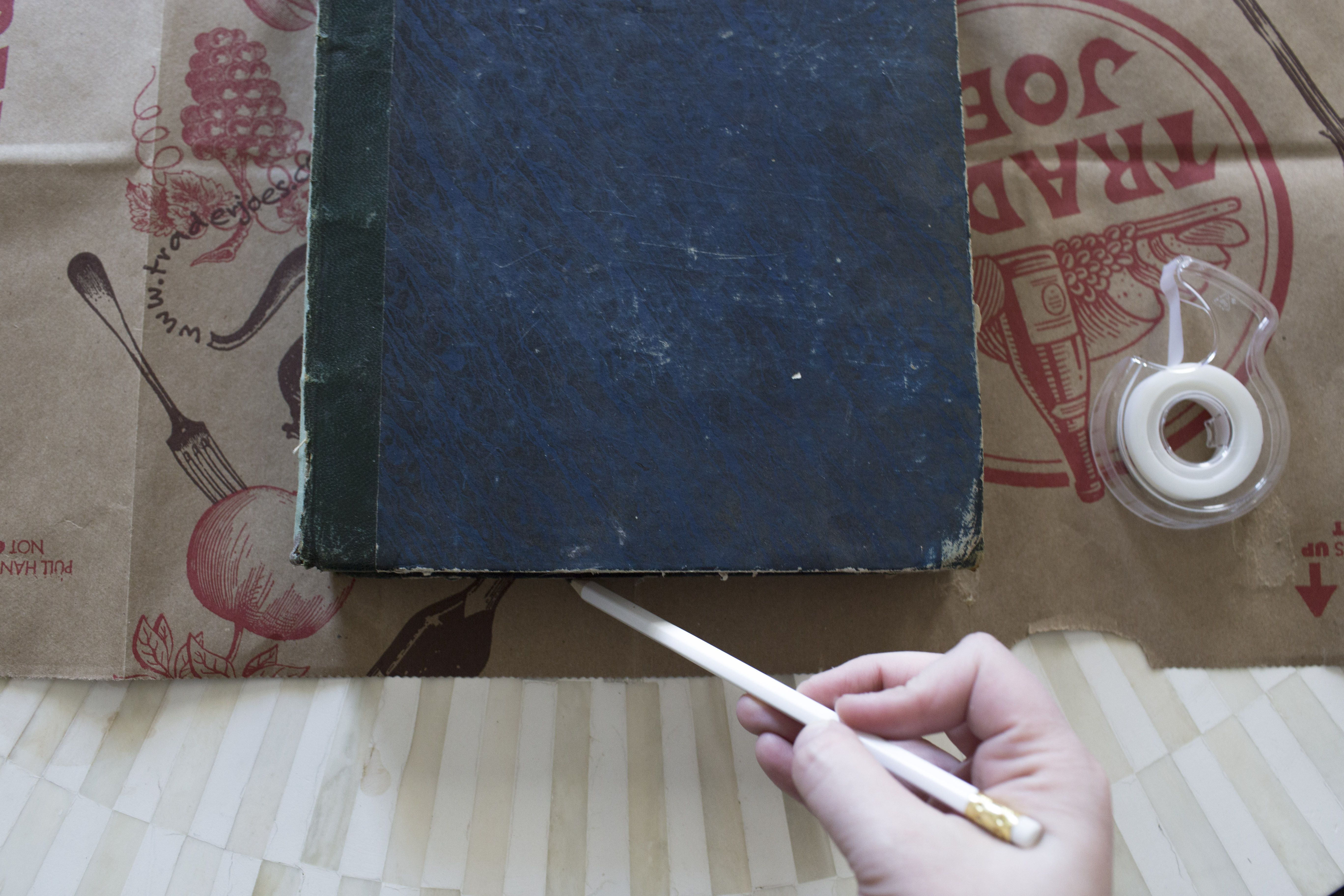 Paper bag book cover: Lay your book on top of the paper bag