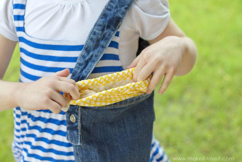 A child holding a denim purse