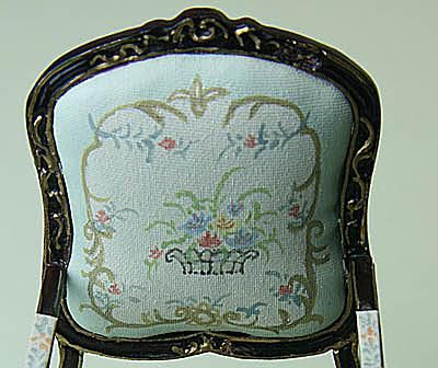 Painted fabric back and simple carving on a Bespaq dolls house miniature chair.