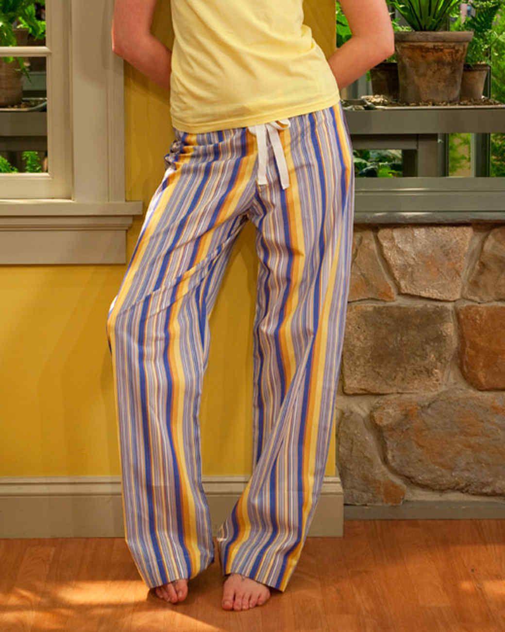 A woman wearing striped drawstring pajama pants