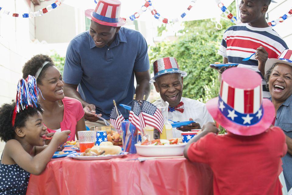 Multi-generation family enjoying Fourth of July barbecue