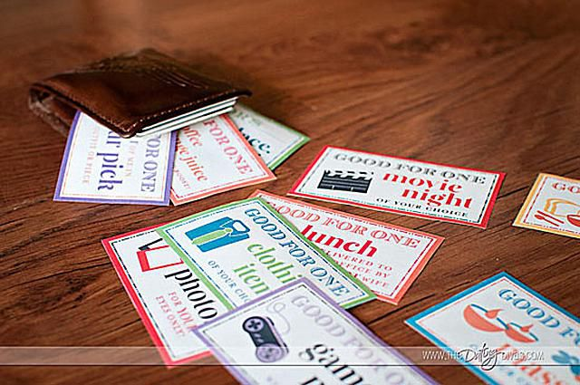 A man's wallet and Father's Day coupons laying on a table.