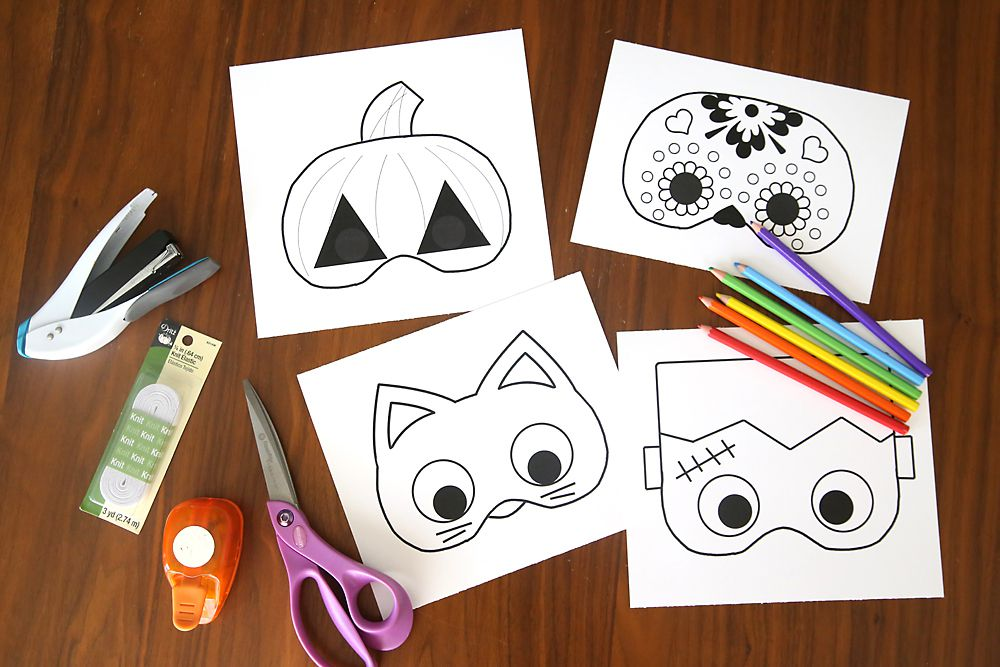 Printable Halloween masks laying on a table