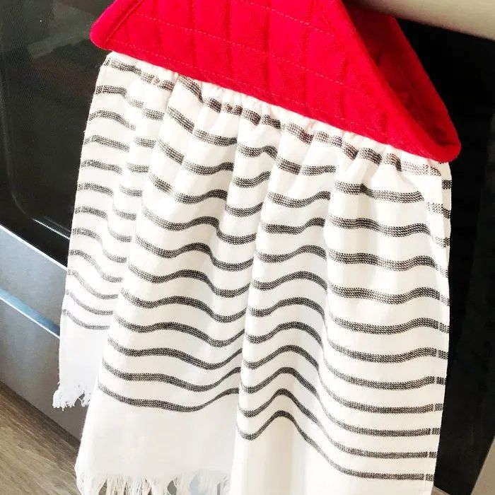 A dish towel hanging on a oven handle