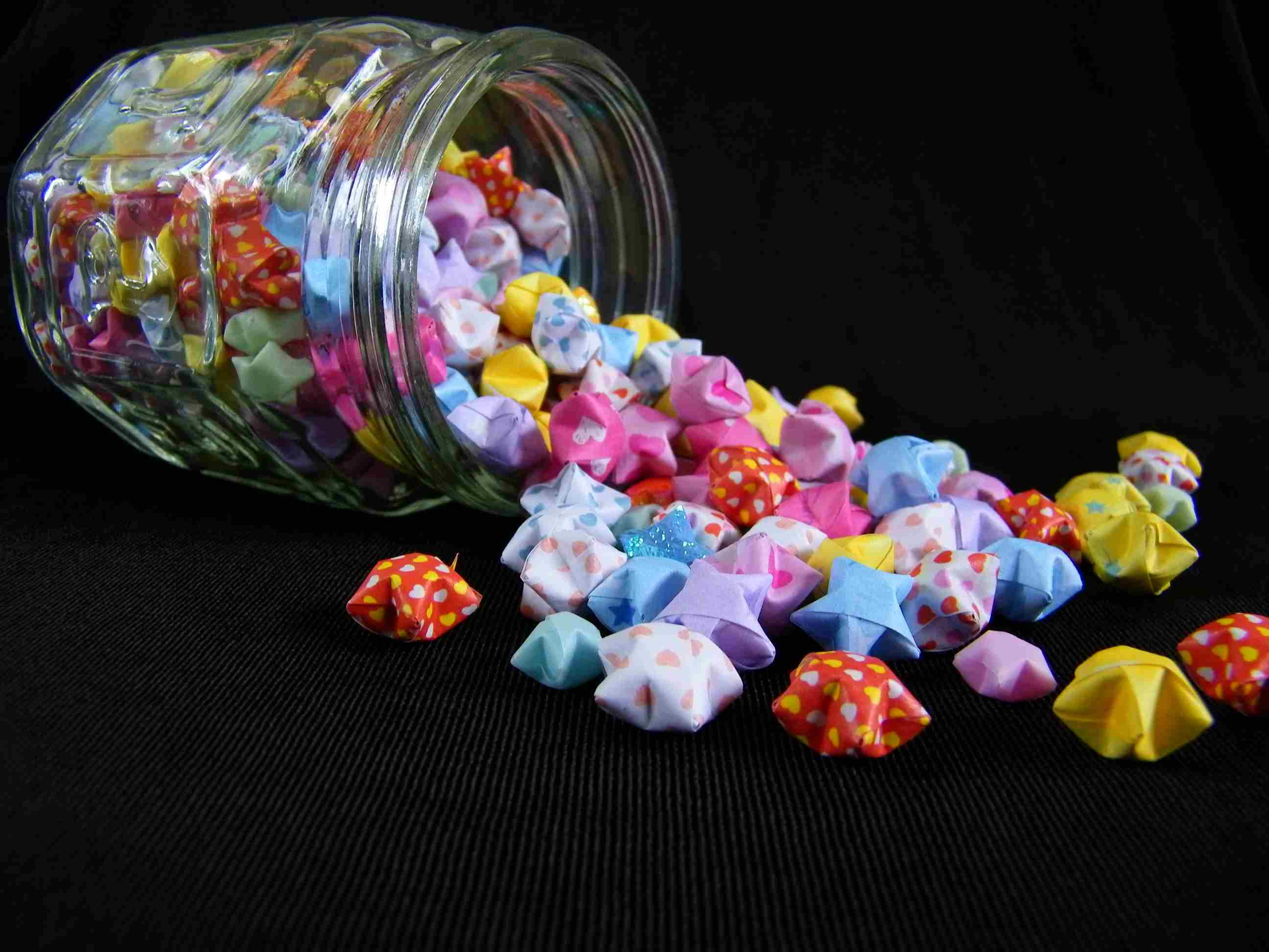 Origami stars spilled out of jar