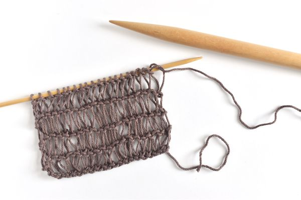 Condo Knitting Swatch on Two Sizes of Knitting Needles