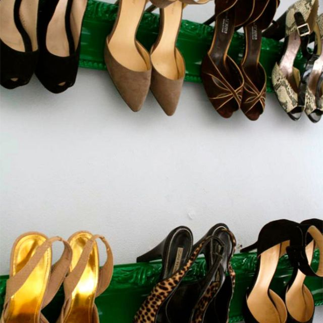Shoes hanging from a green display