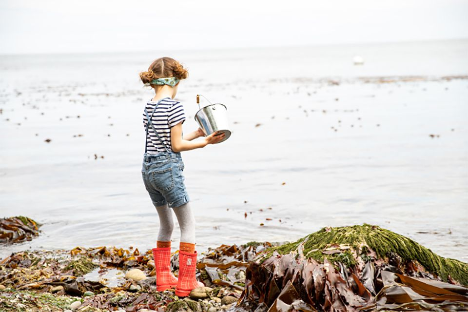 A girl playing in the ocean