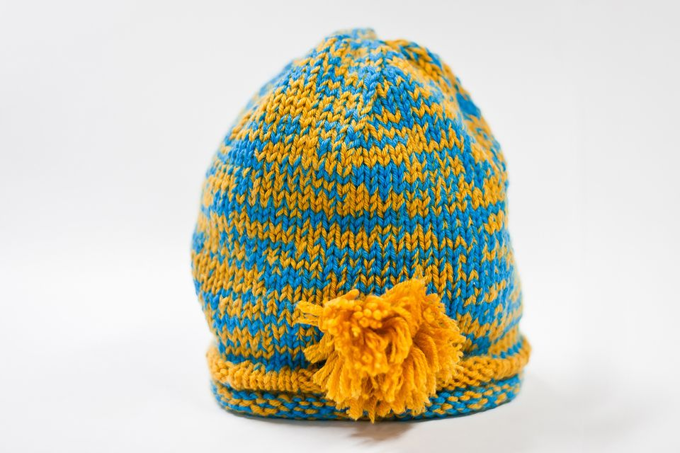 Yellow and blue baby hat
