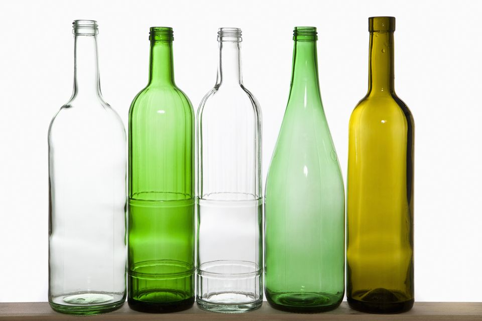 Five empty glass wine bottles