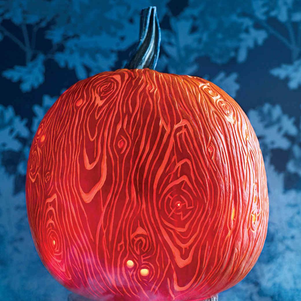 A carved pumpkin that looks like wood grain