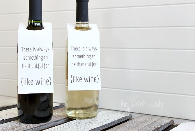 Two bottles of wine with Thanksgiving wine tags
