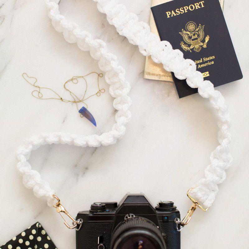 macrame camera strap on white marble background