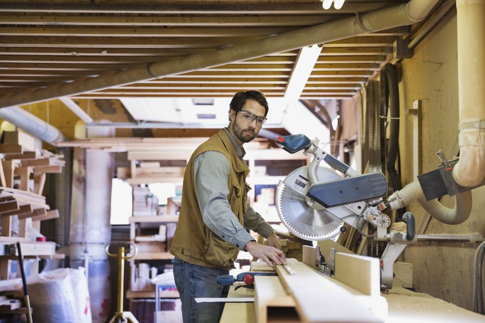 Man using radial arm saw
