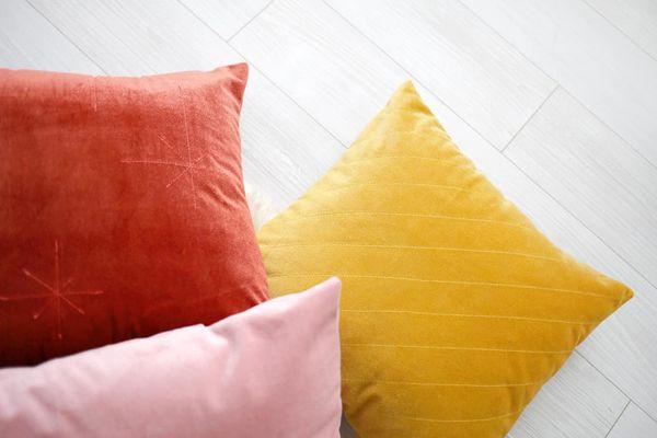 A trio of velvet pillows