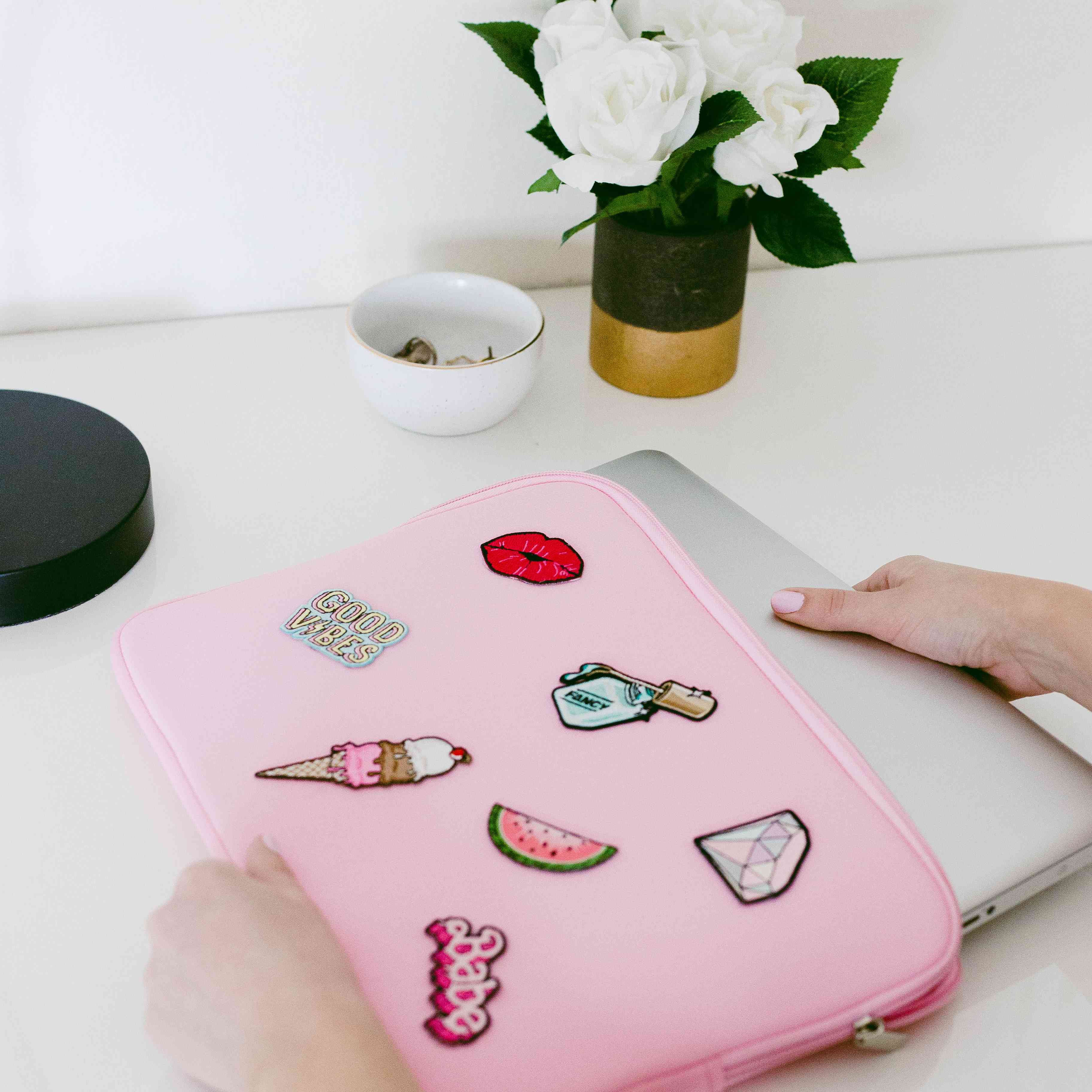 Laptop case with iron-on patches