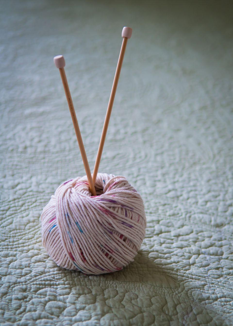 Purl of cotton ball and knitting needles