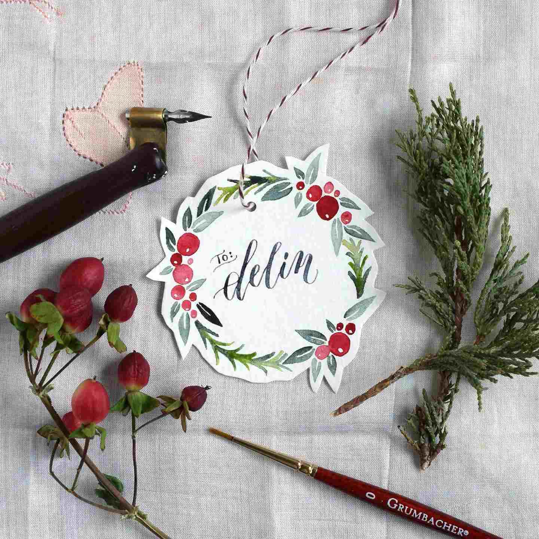 A watercolor holiday gift tag