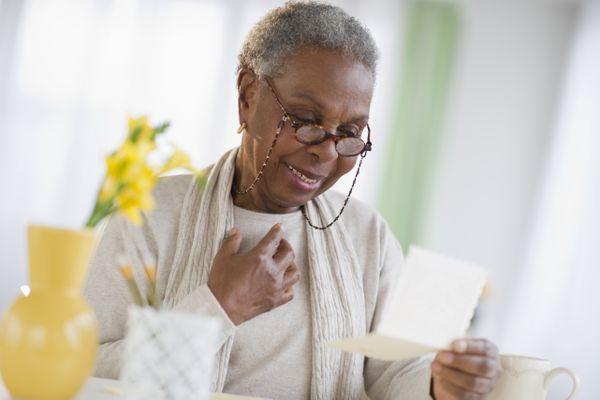 Older woman reading letter