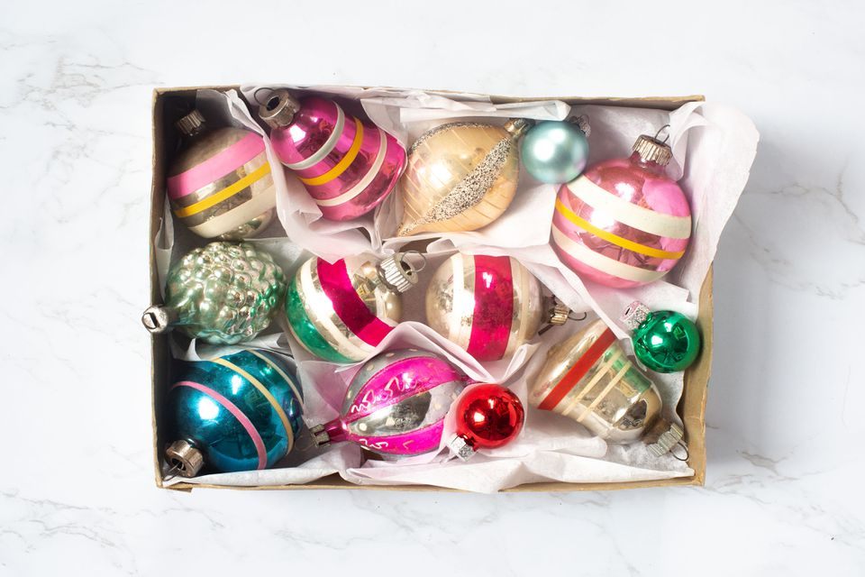 a box of vintage glass ornaments