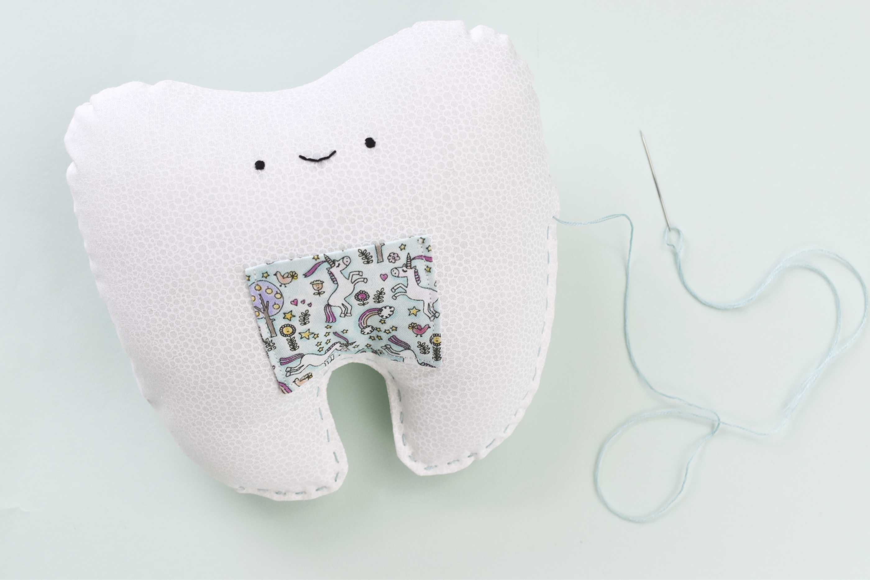 finishing the edges of the tooth fairy pillow