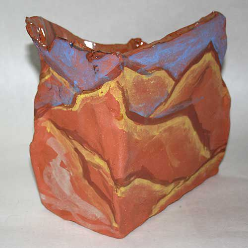 This ceramic box has underglaze decorations on the outside with a glazed interior.
