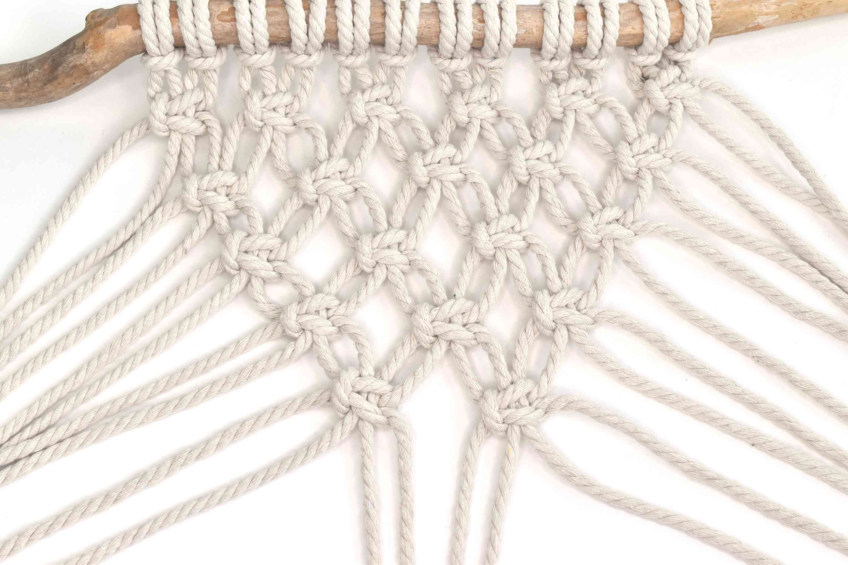 Add more rows of knots until you reach the center point