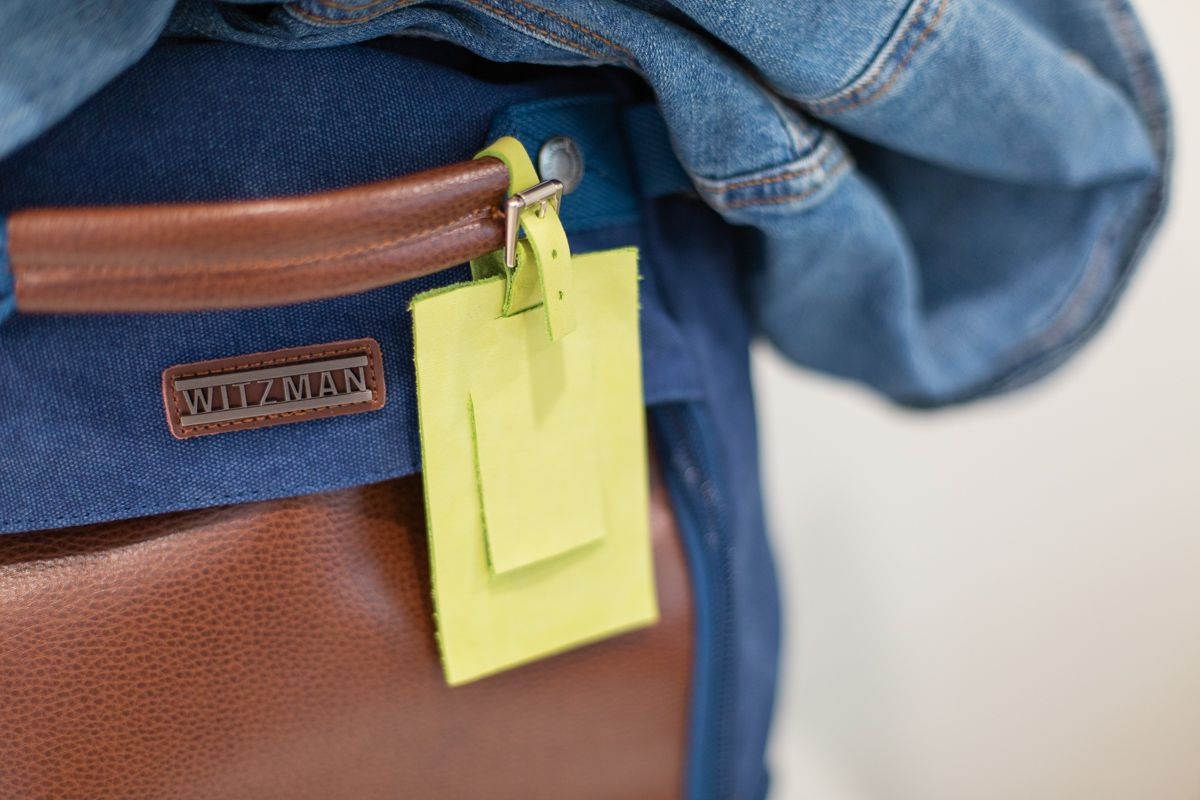DIY leather luggage tag on a suitcase
