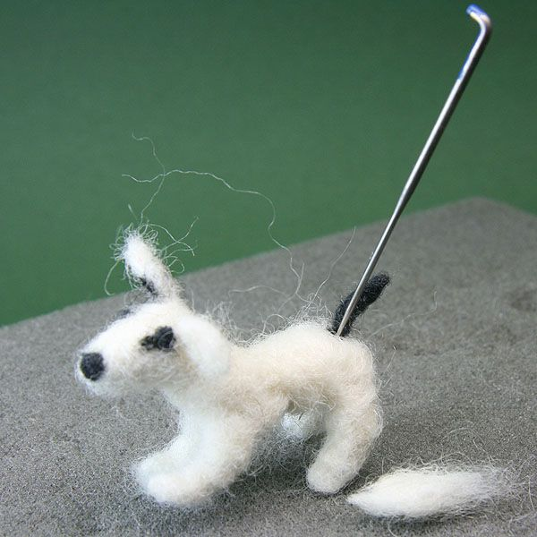 The tail is felted to the back of a dolls house scale Jack Russell Terrier.