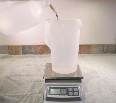 Weighing water on a scale in a pitcher