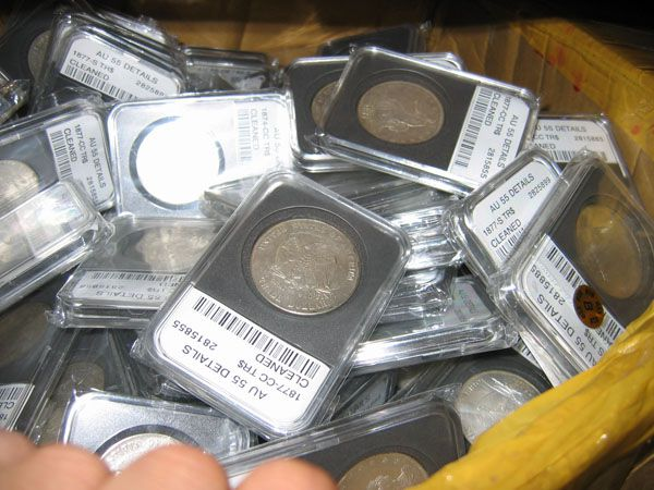 Counterfeit slabs made by a major Chinese fake coin operation.