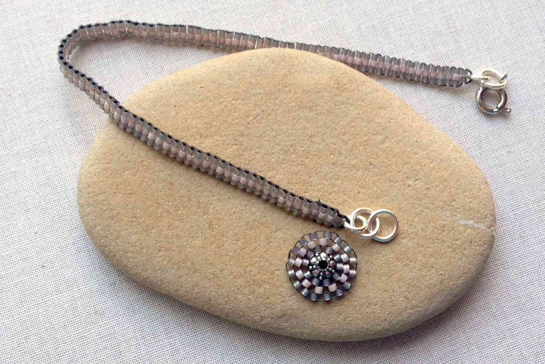 Ladder stitch bracelet with circular brick stitch charm