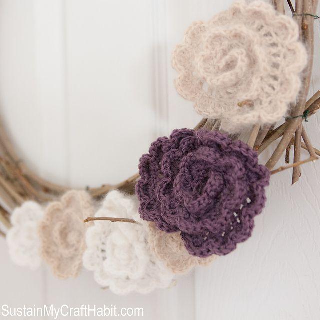 Add crochet flowers to wooden wreaths