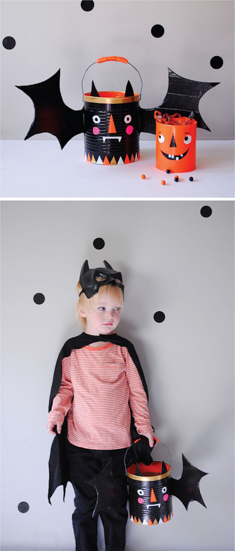 Child modeling a bat-motif duct tape Halloween bucket