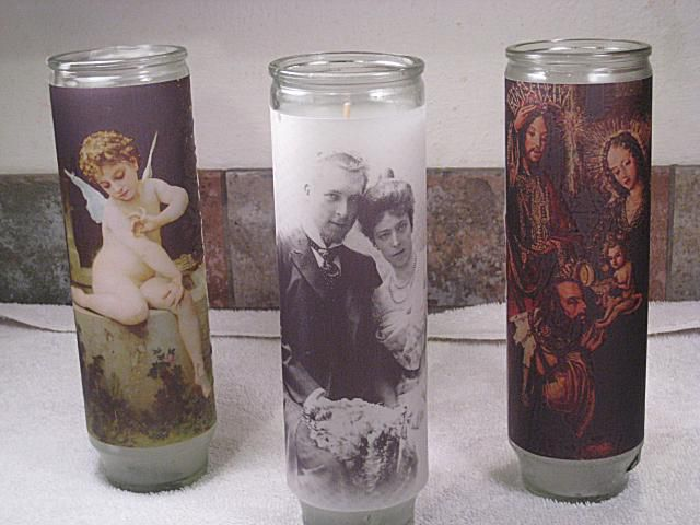 three prayer or devotional candles