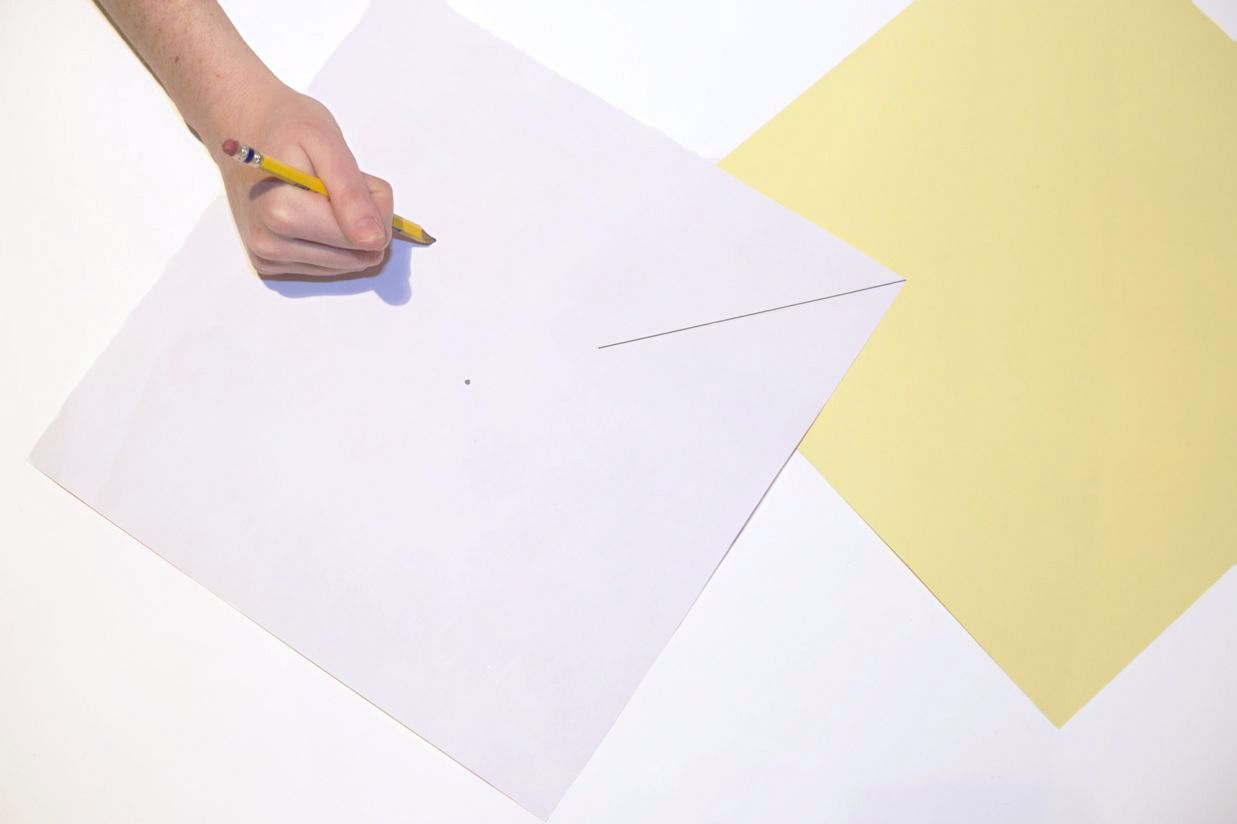 Marking out the cuts to make a paper pinwheel