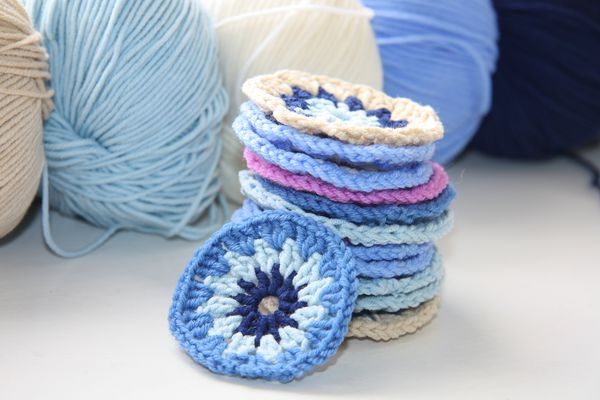 Knitted round pattern of cotton yarn in different colors.