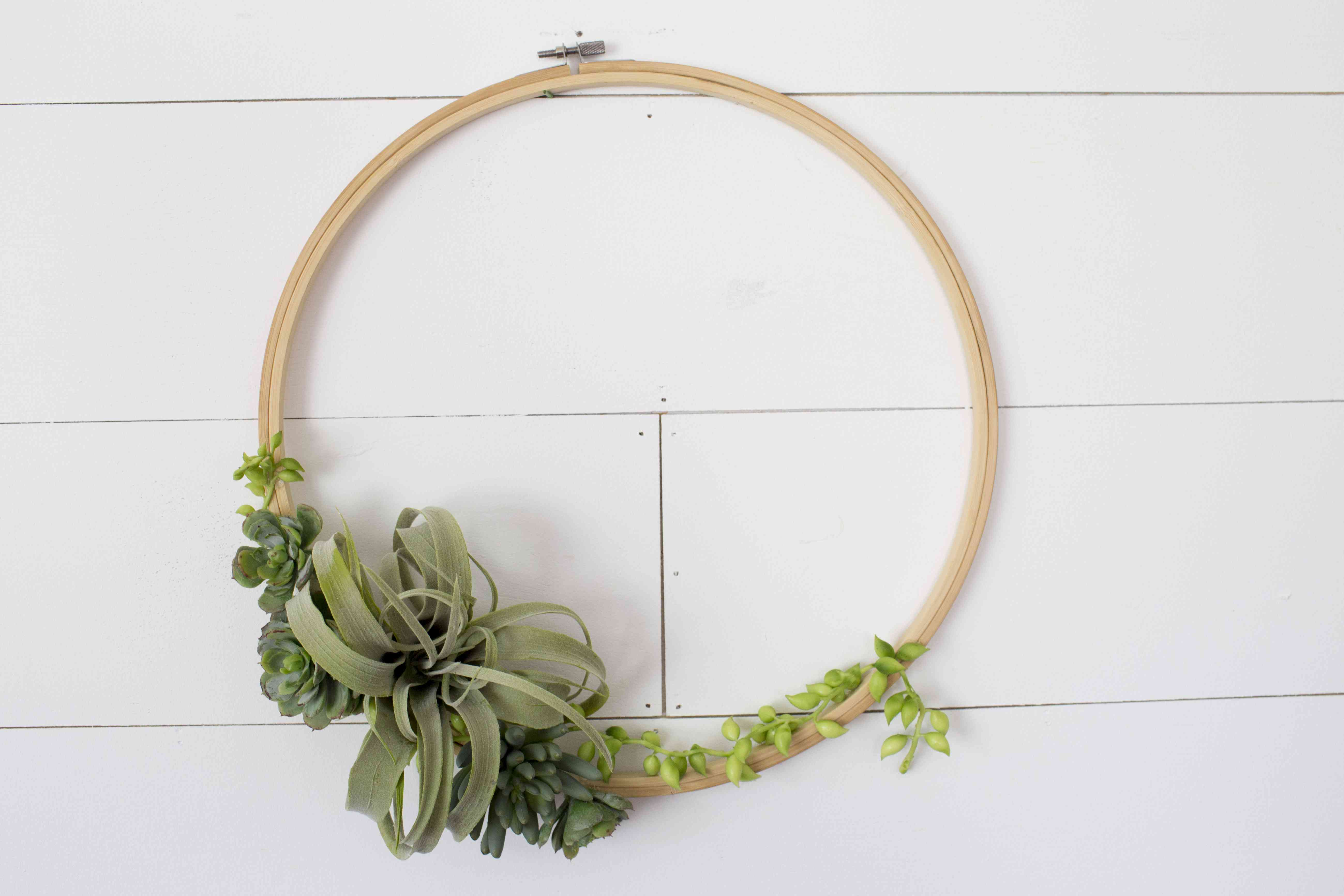 Faux succulent wreath on a white wall