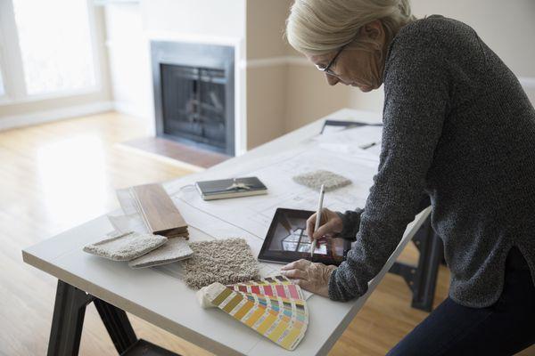 woman choosing carpet colors